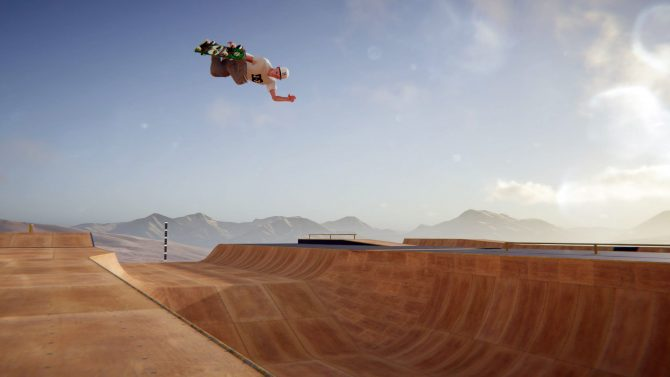 Skater XL player performing a grab above a vert