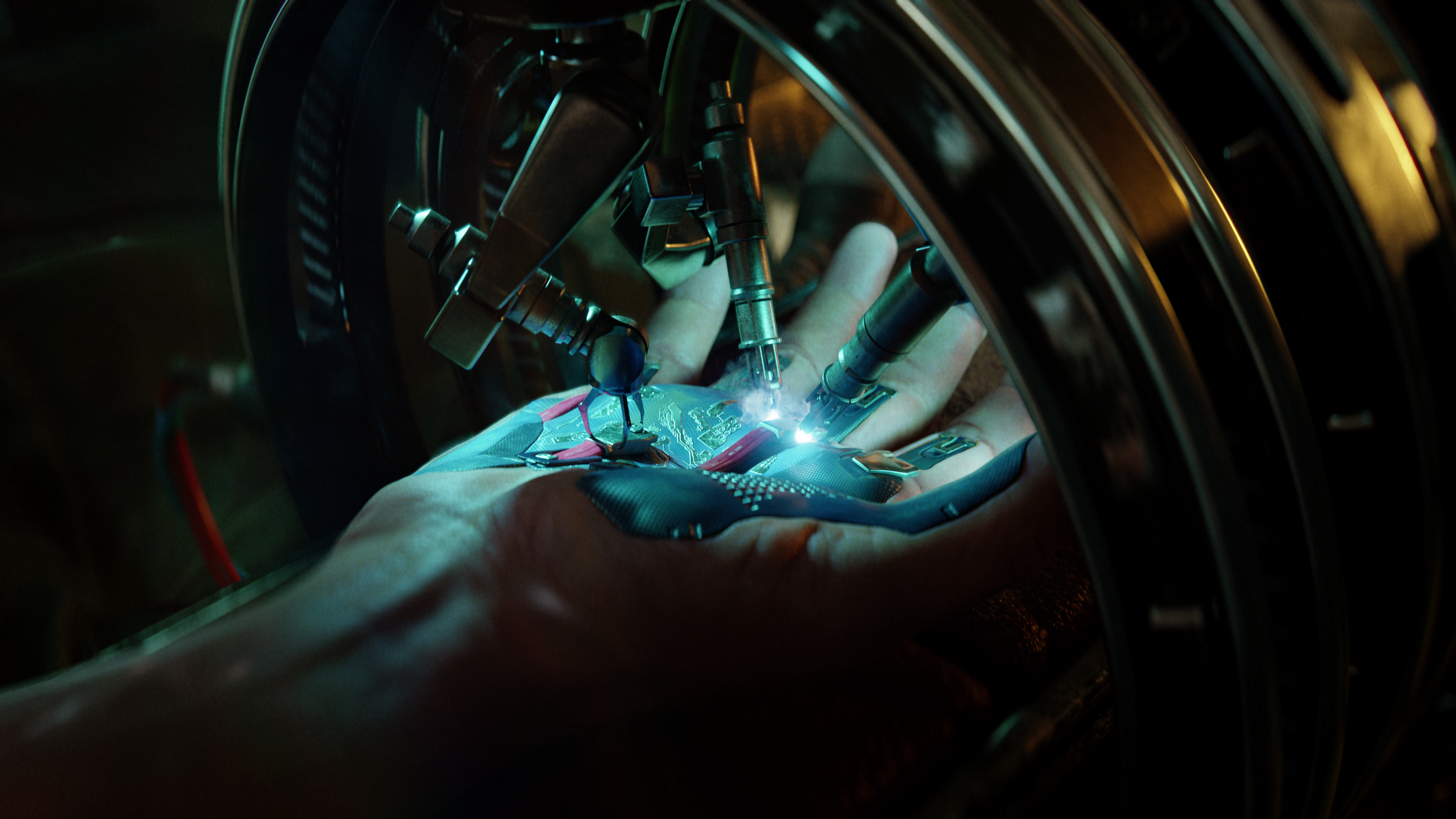 Cyberpunk 2077 key art showing a hand under a blue light being jabbed with robotic needles